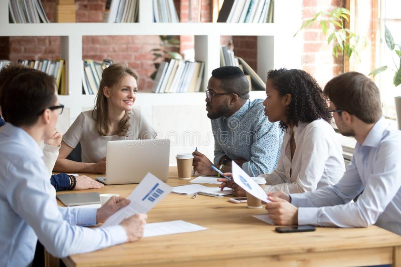 multiracial-millennial-colleagues-brainstorm-discussing-startup-ideas-briefing-boardroom-female-ceo-hold-business-130968623